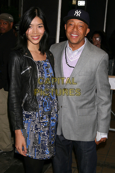 "GUEST & RUSSELL SIMMONS.The Premiere of ""Solitary Man"" at Cinema 2, New York, NY, USA..May 11th, 2010.half length grey gray suit jacket blue pattern dress black leather jacket baseball cap hat.CAP/LNC/TOM.©TOM/LNC/Capital Pictures."