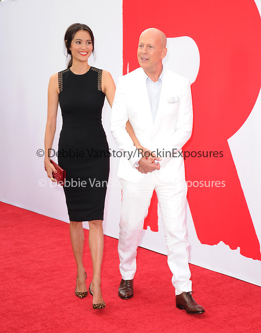 Bruce Willis and  Emma Heming Willis at The Summit Entertainment L.A. Premiere of RED 2 held at Westwood Village in Westwood, California on July 11,2013                                                                   Copyright 2013 Hollywood Press Agency