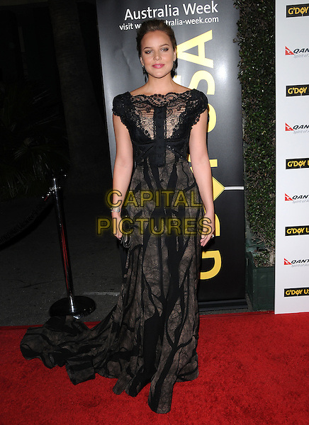 ABBIE CORNISH.at G'Day USA LA Black Tie Gala held at The Hollywood Palladium in Hollywood, California, USA, January 22nd, 2011..full length black lace dress long maxi clutch bag train .CAP/RKE/DVS.©DVS/RockinExposures/Capital Pictures.