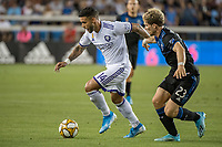 SAN JOSE,  - SEPTEMBER 1: Dom Dwyer  #14 of the Orlando City SC and Florian Jungwirth #23 of the San Jose Earthquakes during a game between Orlando City SC and San Jose Earthquakes at Avaya Stadium on September 1, 2019 in San Jose, .