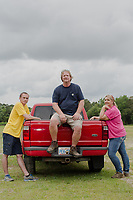 From left: Gage King, 23, his father Thomas King, 53, and wife Sharon King, 48, on their farm where they raise hogs for Smithfield Foods, Inc near Wallace, NC Tuesday, May 15, 2018. (Justin Cook for The Guardian)
