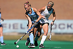 25 October 2014: North Carolina's Julia Young (16) and Wake Forest's Krysta Wangerin (15). The University of North Carolina Tar Heels hosted the Wake Forest University Demon Deacons at Francis E. Henry Stadium in Chapel Hill, North Carolina in a 2014 NCAA Division I Field Hockey match. UNC won the game 3-1.
