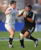 England's Matthew Cox tackles New Zealand tight head Ben Ageaki during the Division A U19 World Championship match at Ravenhill, Belfast.