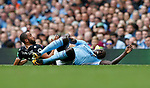 Andros Townsend of Crystal Palace and Benjamin Mendy of Manchester City clash leaving Mendy holding his knee during the premier league match at the Etihad Stadium, Manchester. Picture date 22nd September 2017. Picture credit should read: Simon Bellis/Sportimage