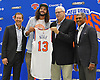 Joakim Noah #13, a free agent signee of the New York Knicks, second from left, poses with, from left, head coach Jeff Hornacek, team president Phil Jackson and general manager Steve Mills at Noah's introductory news conference at Madsion Square Garden Training Center in Greenburgh, NY on Friday, July 8, 2016.