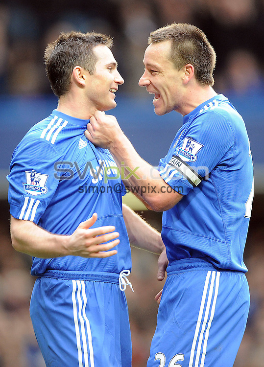 PICTURE BY JEREMY RATA/SWPIX.COM. Barclays Premier league 2009/10 - Chelsea v Aston Villa, Stamford Bridge, London, England. 27th March 2010. Chelsea's Frank Lampard and John Terry celebrate his hat trick and 150th Goal..Copyright - Simon Wilkinson - 07811267706