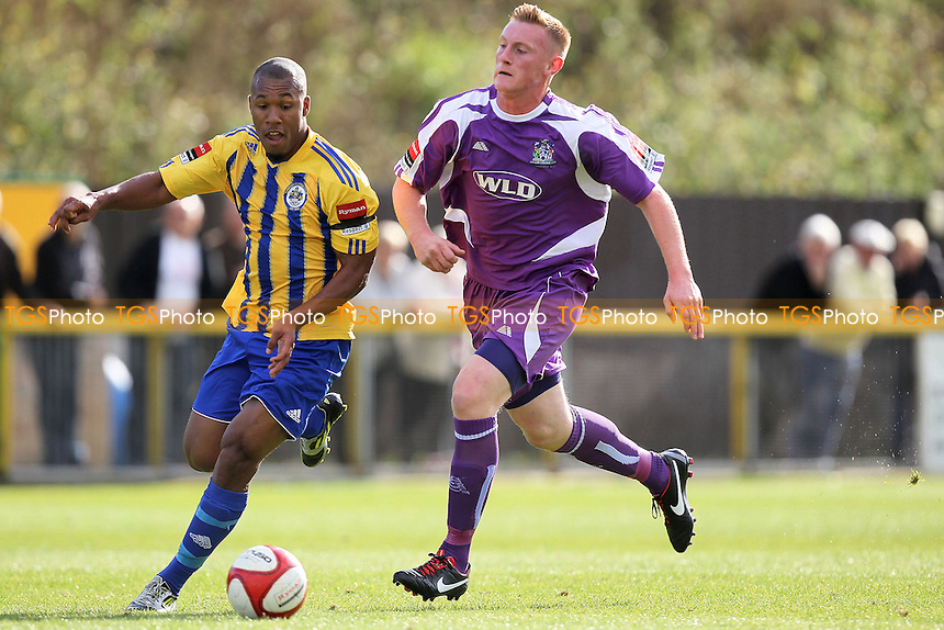 Ryan Imbert of Romford seeks to evade Matt Turpin of Thurrock - Romford vs Thurrock - FA Challenge Trophy 1st Round Football at Ship Lane, Thurrock FC - 29/09/12 - MANDATORY CREDIT: Gavin Ellis/TGSPHOTO - Self billing applies where appropriate - 0845 094 6026 - contact@tgsphoto.co.uk - NO UNPAID USE.