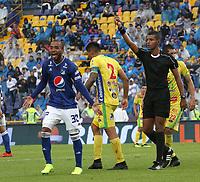 BOGOTÁ - COLOMBIA, 16-02-2019:Leonard Mosquera Gómez referee central muestra la tarjeta roja al jugador Luis Payares de Millonarios durante el  encuentro contra el Atlético Huila partido por la fecha 5 de la Liga Águila I 2019 jugado en el estadio Nemesio Camacho El Campín de la ciudad de Bogotá. / Central referee Leonard Mosquera shows the red card to Luis Payares player of Millonarios  during the match agaisnt of Atletico Huila for the date 5 of the Liga Aguila I 2019 played at the Nemesio Camacho El Campin Stadium in Bogota city. Photo: VizzorImage / Felipe Caicedo / Staff.
