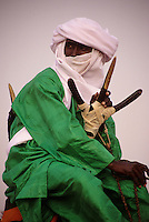 In-Gall, near Agadez, Niger - Tuareg on his Camel at Annual Cure Salé, Annual Gathering of Tuareg Nomads.  As is their custom, this man covers his mouth with the tagulmust, the Tuareg veil.