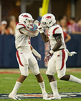 NWA Democrat-Gazette/BEN GOFF @NWABENGOFF<br /> Greg Brooks (left), Arkansas nickelback, and Joe Foucha, Arkansas free safety, celebrate after a stop in the first quarter vs Ole Miss Saturday, Sept. 7, 2019, at Vaught-Hemingway Stadium in Oxford, Miss.