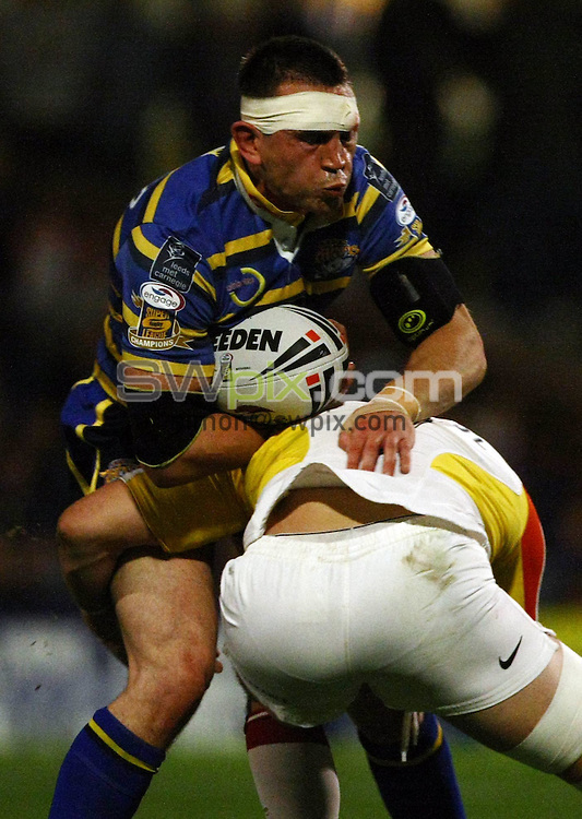 PICTURE BY VAUGHN RIDLEY/SWPIX.COM - Rugby League - Super League Playoffs - Leeds v Catalans - Headingley, Leeds, England  - 02/10/09...Copyright - Simon Wilkinson - 07811267706...Leeds Kevin Sinfield is tackled by Catalans David Ferriol.