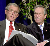 United States President George W. Bush, left, and United States Secretary of Commerce Donald L. Evans, right, listen to remarks at the presentation ceremony for the 2003 recipients of the Malcolm Baldrige National Quality Award.  A record 7 companies were honored with the national award in quality and preformance excellence.   The Baldrige National Quality Program (BNQP) is a public-private partnership to improve the performance of United States organizations.  It manages the annual award that is named for former United States Secretary of Commerce Malcolm Baldrige.  Secretary Baldrige served under United States President Ronald Reagan.<br /> Credit: Ron Sachs / CNP
