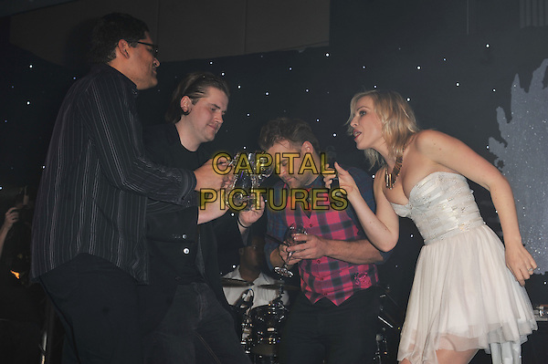 Daniel and Natasha Bedingfield.'Global Angels Awards', The Park Plaza Hotel, Westminster, London, England. 2nd December 2011..music on stage live concert gig performing half length microphone   drink brother sister siblings strapless white dress pink shirt checked tartan plaid  jug drink glass funny .CAP/MAR.© Martin Harris/Capital Pictures.