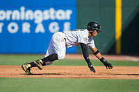 Yoan Moncada (10) of the Charlotte Knights dives back towards first base during the game against the Gwinnett Braves at BB&T BallPark on July 16, 2017 in Charlotte, North Carolina.  The Knights defeated the Braves 5-4.  (Brian Westerholt/Four Seam Images)