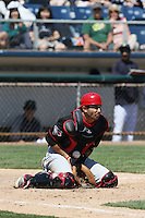 Josh Reavis (5) of the Vancouver Canadians blocks a low throw during a game against the Everett AquaSox at Everett Memorial Stadium on July 28, 2015 in Everett, Washington. Everett defeated Vancouver, 8-5. (Larry Goren/Four Seam Images)