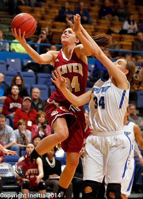 SIOUX FALLS, SD - MARCH 9:  Theresa Wirth #34 from Denver  takes the ball to the basket against Rebecca Bruner #34 from IPFW in the second half of their game Sunday afternoon at the 2014 Summit League Basketball Tournament in Sioux Falls, SD. (Photo by Dave Eggen/Inertia)