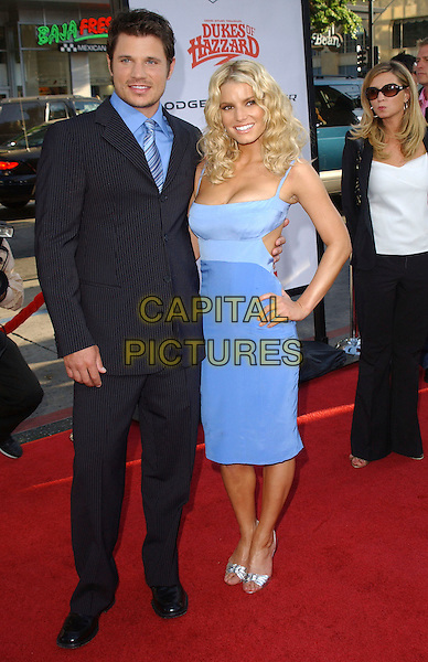 "NICK LACHEY & JESSICA SIMPSON.The Warner Brothers World Premiere of ""The Dukes of Hazzard"" held at The Grauman's Chinese Theatre in Hollywood, California  .July 28th, 2005.full length blue dress hand on hip celebrity couple married husband wife blue pinstripe suit silver shoes.www.capitalpictures.com.sales@capitalpictures.com.Supplied By Capital PIctures"