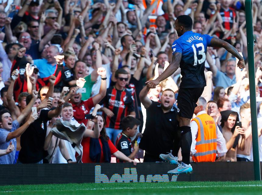 Bournemouth's Callum Wilson celebrates scoring his sides fourth goal  and his Hattrick<br /> <br /> Photographer Kieran Galvin/CameraSport<br /> <br /> Football - Barclays Premiership - West Ham United v Bournemouth - Saturday 22nd August 2015 - Boleyn Ground - London<br /> <br /> <br /> &copy; CameraSport - 43 Linden Ave. Countesthorpe. Leicester. England. LE8 5PG - Tel: +44 (0) 116 277 4147 - admin@camerasport.com - www.camerasport.com