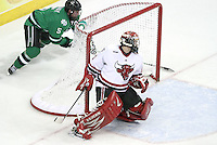 North Dakota's Chay Genoway beats University of Nebraska Omaha goalie John Faulkner with a wraparound goal in the third period. No. 8 North Dakota used a three-goal third period to beat No. 4 UNO 6-5 Friday night at Qwest Center Omaha. (Photo by Michelle Bishop)
