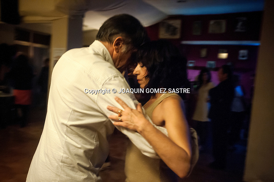 A couple dancing a tango in the local Association of tango friends.<br />  PHOTO &copy; JOAQUIN GOMEZ  SASTRE