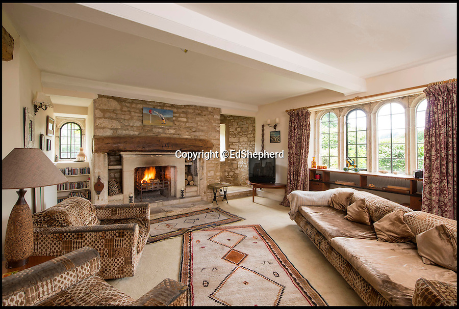 BNPS.co.uk (01202 558833)<br /> Pic: Strutt&Parker/BNPS<br /> <br /> This picturesque home in the heart of the bucolic Slad valley where Laurie Lee grew up is the perfect place to enjoy the idyllic country life - and you can even make your own cider for Rosie.<br /> <br /> The Grade II listed Knapp House, which has a cider press in the next-door barn, is believed to be the spot where the cider referred to in the famous book was made.<br /> <br /> The beautiful Cotswolds property is set in the Slad Valley, which was immortalised in the novel and is where the author spent his childhood.<br /> <br /> Now one lucky buyer can follow in Laurie Lee's footsteps as the property is on the market for £2million with Strutt & Parker.