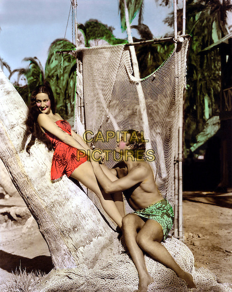 Dorothy Lamour & Jon Hall.in The Hurricane.*Filmstill - Editorial Use Only*.CAP/PLF.Supplied by Capital Pictures.