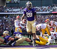 Richard Newton dances into the end zone for Washington's first touchdown.