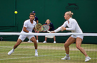 London, England, 4th July, 2016, Tennis, Wimbledon, Mixed Doubles: Kiki Bertens (NED) and Jean-Julien Rojer (NED)<br /> Photo: Henk Koster/tennisimages.com