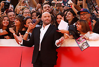 Actor John Travolta poses on the red carpet at the international Rome Film Festival at Rome's Auditorium, October 22, 2019.<br /> UPDATE IMAGES PRESS/Riccardo De Luca