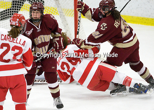 Jill Cardella (BU - 22), Shannon Webster (BC - 12), Melissa Anderson (BU - 24), Mary Restuccia (BC - 22) - The Boston College Eagles and Boston University Terriers played to a 1-1 tie in the 2010 Beanpot consolation game on Tuesday, February 9, 2010 at the Bright Hockey Center in Cambridge, Massachusetts.