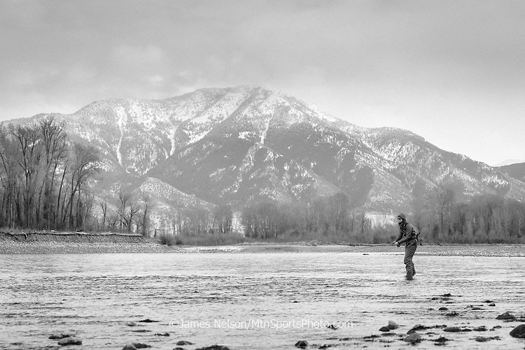 Alexis Metcalf fishes for trout during a winter day on the South Fork of the Snake River, Idaho.