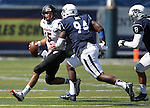 Nevada defenders Lenny Jones (94) and Ian Seau (8) pursue Southern Utah's quarterback Aaron Cantu (15) during the second half of an NCAA college football game on Saturday, Aug. 30, 2014 in Reno, Nev. (AP Photo/Cathleen Allison)