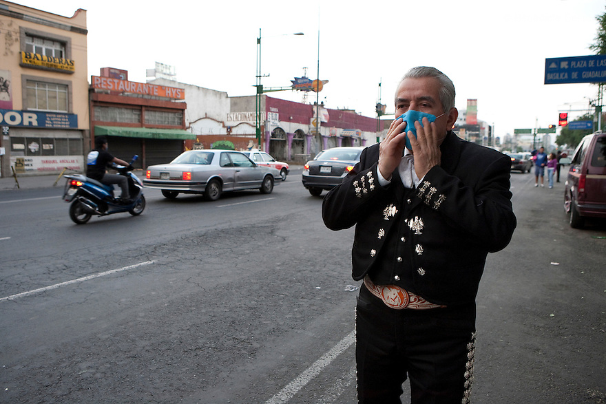 27 April 2009 - Mexico City, Mexico - Mariachis wear surgical masks to protect themselves from the swine Flu in Garibaldi square Mexico City. The mariachis have less work as Mexicans stay in their house. Most social activities have come to a stop. Photo credit: Benedicte Desrus / Sipa Press