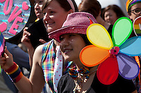 People parade in colourful costumes during Tokyo Rainbow Pride festival, Yoyogi Park, Tokyo, Japan. Sunday April 27th 2014 This was the third year this annual gay-pride event has been held in Japan capital.with food, fashion and health care stalls and musical performances set up in Yoyogi Park event square and a colourful parade around Shibuya at 1pm.