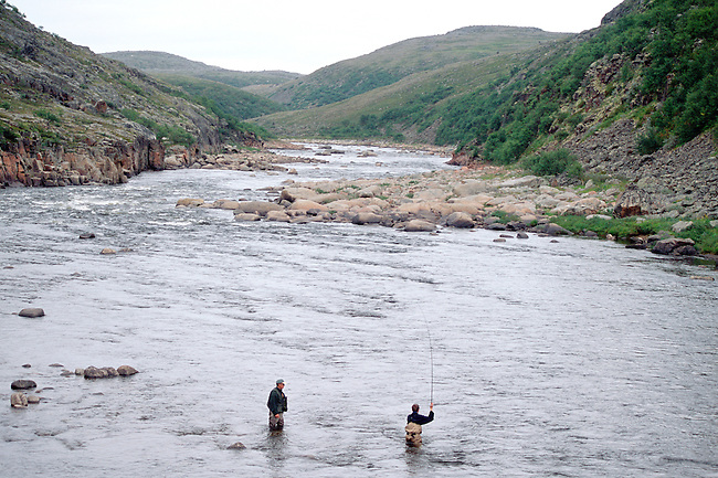 A salmon angler with his guide fly fishing on the Eastern Litza River. Kola Peninsula, NW Russia.