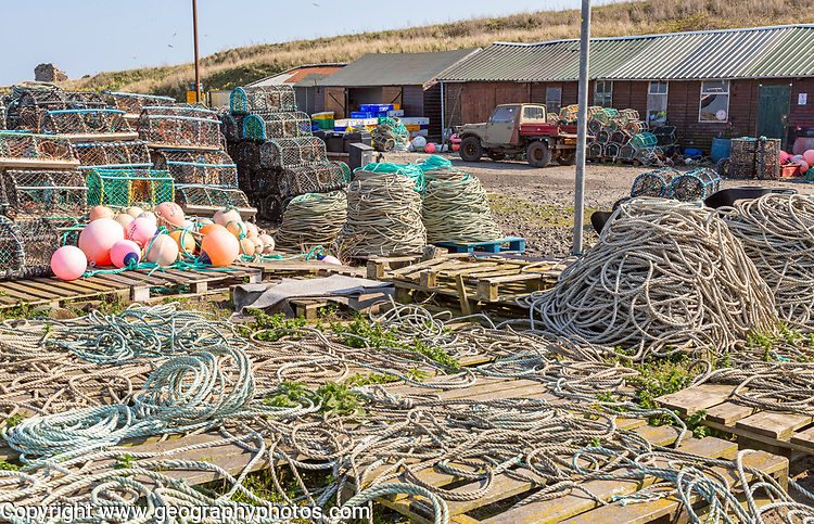 Fishing ropes, lobster pots and equipment on quayside Holy Island, Lindisfarne, Northumberland, England, UK