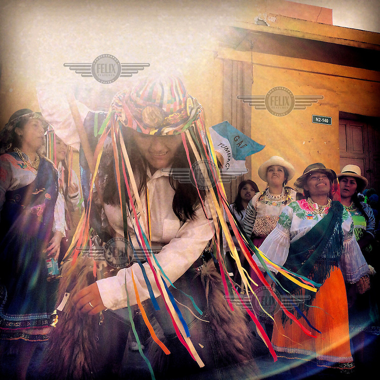 Students from Universitec dance and sing in the streets during the fiestas of Tumbaco. They are wearing traditional clothing from Cayambe.