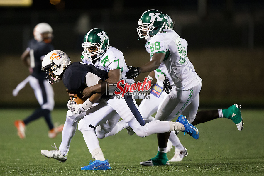 Jonathan Ifedi (7) of the Vance Cougars is tackled by Jayln Cagle (7) of the A.L. Brown Wonders during first half action at Rocky River High School on October 5, 2015 in Charlotte, North Carolina.  The Wonders defeated the Cougars 31-14.  (Brian Westerholt/Sports On Film)
