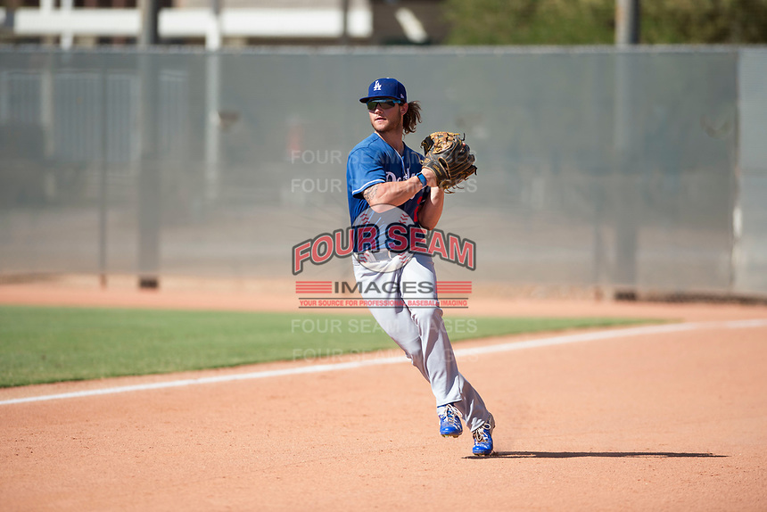 Los Angeles Dodgers right fielder Andrew Shaps (27) prepares to make a throw to second base during an Instructional League game against the Milwaukee Brewers at Maryvale Baseball Park on September 24, 2018 in Phoenix, Arizona. (Zachary Lucy/Four Seam Images)