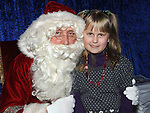 Samantha Jirensone pictured with Santa at his grotto at the Drogheda Town Centre. Photo: Colin Bell/pressphotos.ie