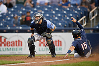 Trenton Thunder catcher Ryan Lidge (43) looks on as Connor Panas (15) slides home during a game against the New Hampshire Fisher Cats on August 19, 2018 at ARM & HAMMER Park in Trenton, New Jersey.  New Hampshire defeated Trenton 12-1.  (Mike Janes/Four Seam Images)
