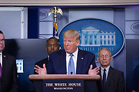 United States President Donald J. Trump makes remarks on the Coronavirus crisis in the Brady Press Briefing Room of the White House in Washington, DC on Saturday, March 21, 2020.  Standing behind the President, from left to right: Pete Gaynor, Administrator, Federal Emergency Management Agency (FEMA); US Secretary of Housing and Urban Development (HUD) Ben Carson; and Director of the National Institute of Allergy and Infectious Diseases at the National Institutes of Health Dr. Anthony Fauci.<br /> Credit: Stefani Reynolds / Pool via CNP/AdMedia