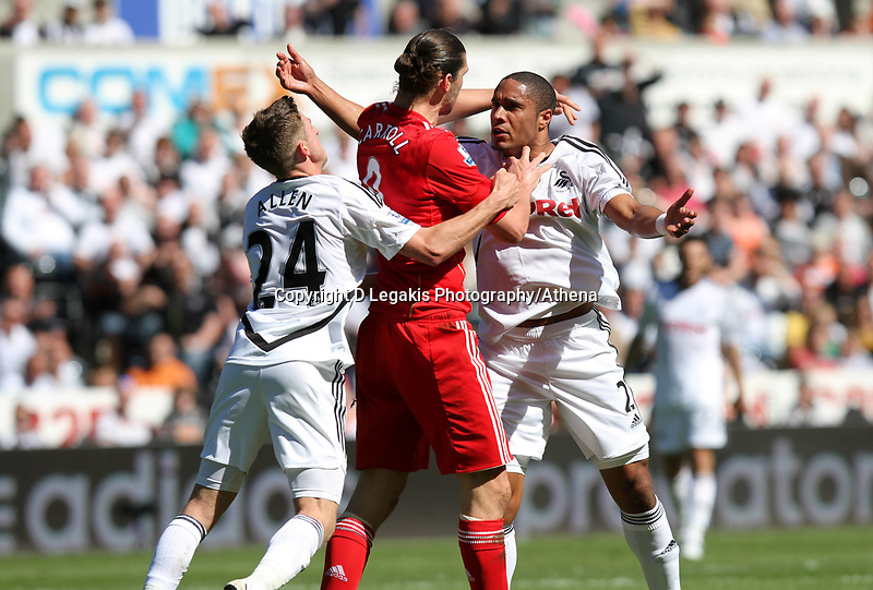 Barclay Premier League, Swansea City (white) V Liverpool (red) Liberty Stadium, 13/05/12<br /> Pictured: Andy Carroll and Ashley Williams came to blows after a challenge by Williams. Here Joe Allen tries to break them up<br /> Picture by: Ben Wyeth / Athena <br /> info@athena-pictures.com