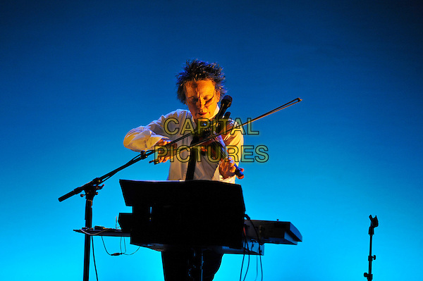 Laurie Anderson .performing live in concert as part of the Meltdown Festival, Royal Festival Hall, Waterloo, London, England, UK, .3rd August 2012..music gig on stage half length violinist violin white shirt .CAP/MAR.© Martin Harris/Capital Pictures.
