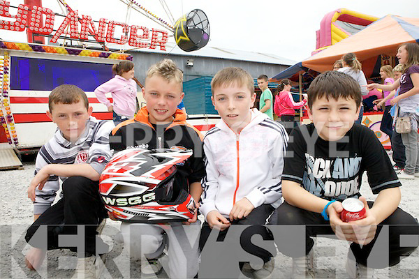 Enjoying the carnival atmosphere in Athea last Saturday was Shane Daughton(Athea), Adam Riordan(Abbeyfeale) and Liam McAuliffe with John Sexton(Athea) as part of the Athea Motorcycle Road Race.