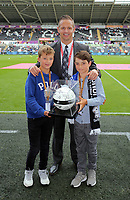 Lee Trundle with matchball sponsors before the Premier League match between Swansea City and Chelsea at The Liberty Stadium on September 11, 2016 in Swansea, Wales.