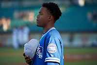 Oklahoma City Dodgers Errol Robinson (6) during the national anthem before a Pacific Coast League game against the New Orleans Baby Cakes on May 6, 2019 at Shrine on Airline in New Orleans, Louisiana.  New Orleans defeated Oklahoma City 4-0.  (Mike Janes/Four Seam Images)