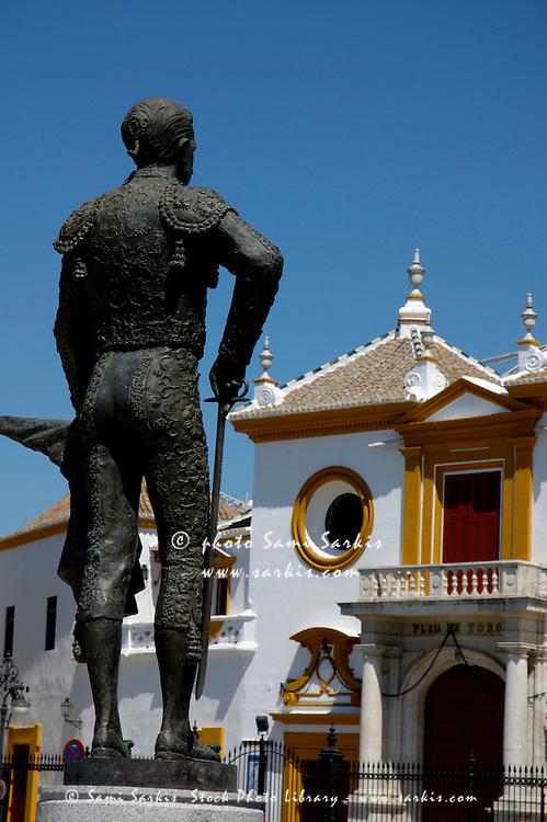 Statue outside the entrance to Plaza de Toros de la Real Maestranza de Caballeria de Sevilla, Spain's oldest bullring arena, Seville, Andalusia, Spain.