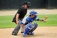 Lexington Legends catcher Jin-Ho Shin (32) sets a target as home plate upire Jordan Albarado looks on during the South Atlantic League game against the Kannapolis Intimidators at CMC-Northeast Stadium on July 31, 2013 in Kannapolis, North Carolina.  The Intimidators defeated the Legends 3-2.  (Brian Westerholt/Four Seam Images)