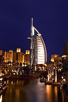 Dubai, United Arab Emirates. Madinat Jumeirah. Burj al Arab Hotel, &#xD;Mina A'Salam Hotel and Convention Centre. Souk. Evening.&#xD;<br />